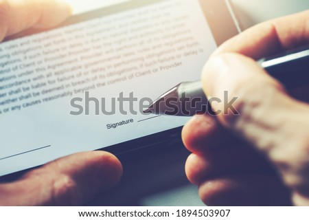 electronic signature concept - man sign distance contract with digital pen in mobile phone Royalty-Free Stock Photo #1894503907