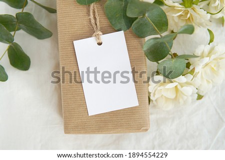 Thank you gift tag mockup for wedding, bridal shower, rustic wedding favor tag, rectangle  label mock up on kraft paper box, eucalyptus branches, white flowers.