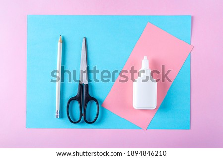 DIY and kid's creativity, origami. Step by step instruction: how to make bookmark easter bunny. Step1 preparation tools (colored paper, scissors, glue, pencil). Easter craft
