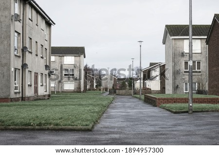 Derelict council house in poor housing estate slum with many social welfare issues in Port Glasgow Royalty-Free Stock Photo #1894957300