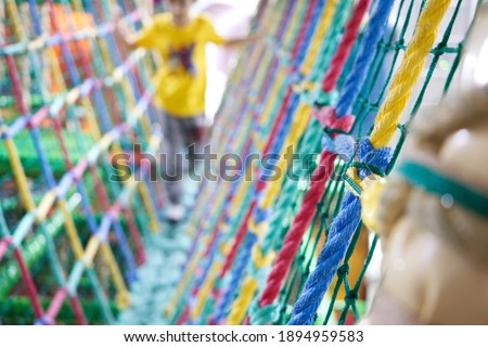 Indoor playground background. Rope playground equipment. Indoor adventure playground for children's body and mind development.  Royalty-Free Stock Photo #1894959583
