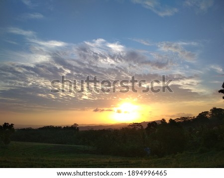 a sunset view from the top of a hill  #1894996465
