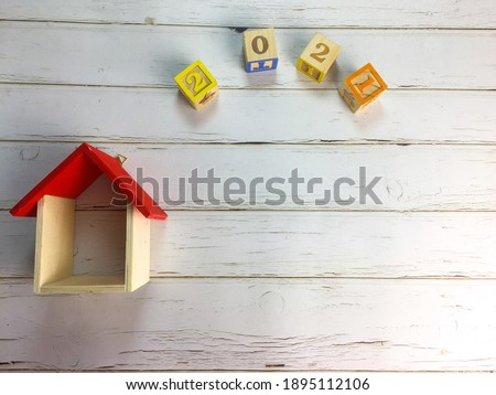 Wooden block with word of new year 2021.  Inscription with replica house. There are several different types of arrangements. Selective focus.