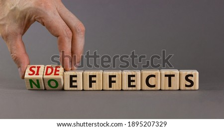 Side or no effects symbol. Hand turns wooden cubes and changes words 'no effects' to 'side effects'. Beautiful grey background, copy space. Medical, covid-19 pandemic corona side effects concept. Royalty-Free Stock Photo #1895207329