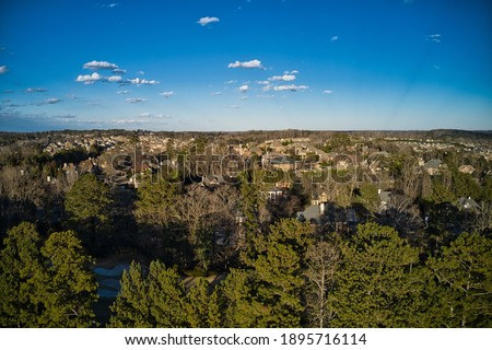 Aerial panoramic view of house cluster in a sub division in Suburbs   in metro Atlanta in Georgia ,USA shot by drone shot during golden hour Royalty-Free Stock Photo #1895716114