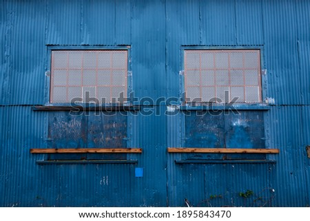 Condemned windows in an old warehouse Royalty-Free Stock Photo #1895843470