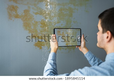 Taking Picture Or Photo Of House Water Leak Damage