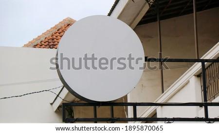 Circle sign mockup at front of door cafe