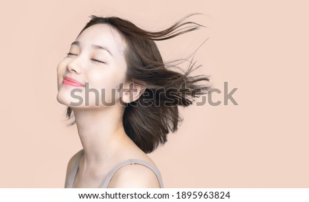 Beauty concept of a young asian woman. Hair care. Cosmetics. Royalty-Free Stock Photo #1895963824