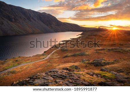 Aerial view of Wastwater with beautiful sunset clouds in sky. Lake District, UK. Royalty-Free Stock Photo #1895991877