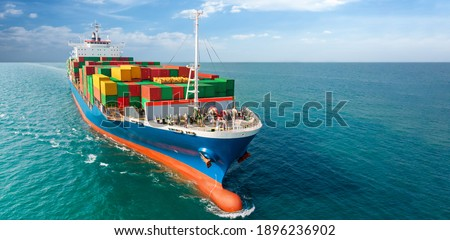 Aerial side view of smart cargo ship carrying container from custom container depot go to ocean concept freight shipping by ship service on blue sky background. Royalty-Free Stock Photo #1896236902