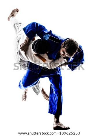 two judokas fighters fighting men in silhouettes on white background Royalty-Free Stock Photo #189625250
