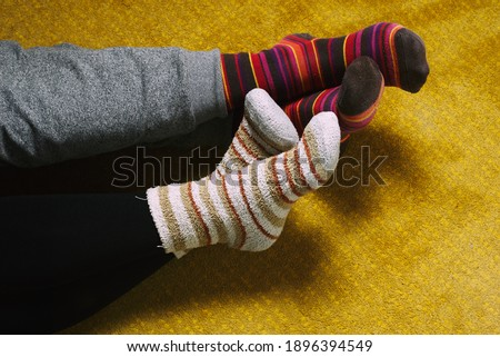feet with socks of man and woman. love, valentine's day #1896394549