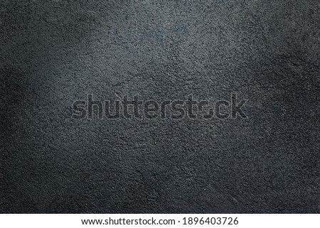 Dark textured asphalt black background.  Royalty-Free Stock Photo #1896403726