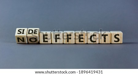 Side or no effects symbol. Turned wooden cubes and changed words 'no effects' to 'side effects'. Beautiful grey background, copy space. Medical, covid-19 pandemic corona side effects concept. Royalty-Free Stock Photo #1896419431