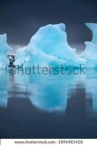 Jokulsarlon glacier lagoon, Vatnajokull national park, Iceland. Ocean bay and icebergs. Summer season. Natural Icelandic landscape. Reflection on water surface. Travel and vacation Royalty-Free Stock Photo #1896485428