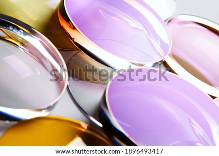 Glass lenses coated glasses optics close-up Royalty-Free Stock Photo #1896493417