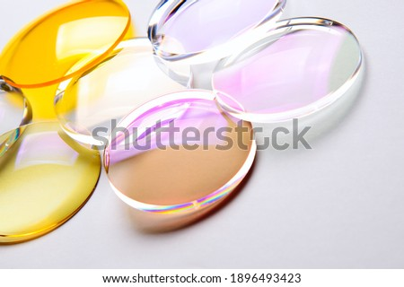 Round lenses for glasses with anti-reflective coating on a white background. Production of glasses and spectacle lenses. Royalty-Free Stock Photo #1896493423
