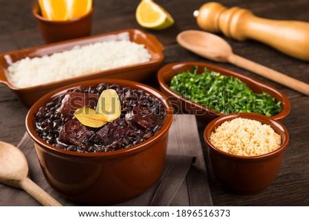 Feijoada, a typical Brazilian food Royalty-Free Stock Photo #1896516373