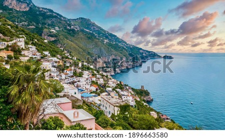 The charming Italian seaside town of Praiano, perched above steep rocky cliffs with magnificent views of the Amalfi coast. Royalty-Free Stock Photo #1896663580