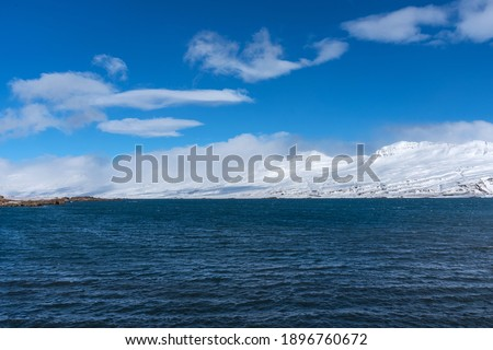 Beautiful winter view of picturesque Atlantic Ocean in Iceland. A waves of the Atlantic Ocean hit the coast of Iceland. The coast of Atlantic Ocean in winter. Royalty-Free Stock Photo #1896760672