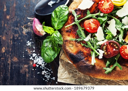 pizza and fresh italian ingredients on a dark background #189679379