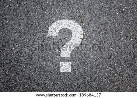 Question mark on road background
