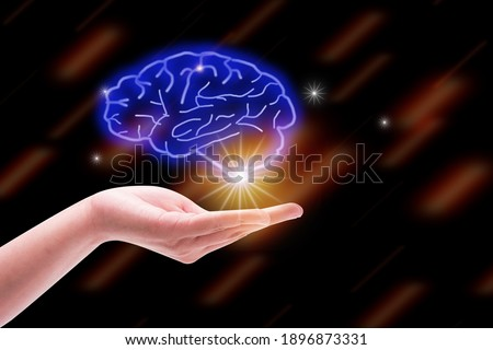New idea business and Brain icon concept, hand holding brain icon and star control in graph Screen Icon of a media screen, idea Business concept.