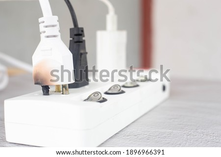 Improper use of the AC power plug and socket can cause a short circuit. Cause a fire And damage electrical appliances. Royalty-Free Stock Photo #1896966391
