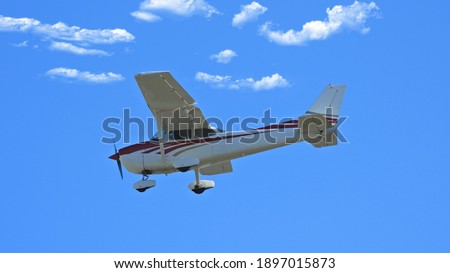 Zoom photo of small propeller airplane landing to small airport
