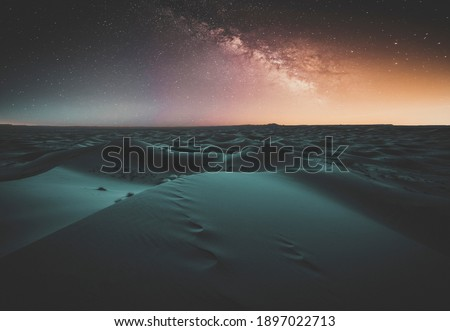 Amazing milky way over the dunes Erg Chebbi in the Sahara desert at Morocco, Africa. Beautiful sand landscape with stunning sky full of stars and night under a starry sky. After sunset. Black desert Royalty-Free Stock Photo #1897022713