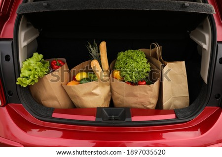 Bags full of groceries in car trunk, closeup view Royalty-Free Stock Photo #1897035520