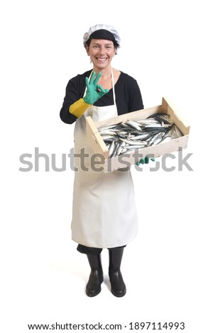 full portrait of a fishmonger holding a box of sardine and ok sign on white background