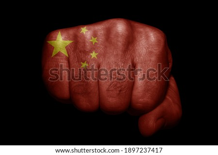 Flag of China painted on strong fist on black background Royalty-Free Stock Photo #1897237417