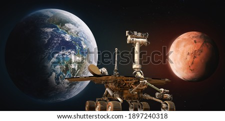 Earth and Mars planet. Rover Perseverance. Space mission to red planet. Exploration. Elements of this image furnished by NASA. Royalty-Free Stock Photo #1897240318