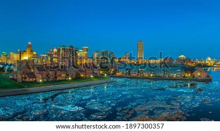 Buffalo New York skyline landscape view at night from erie basin marina.