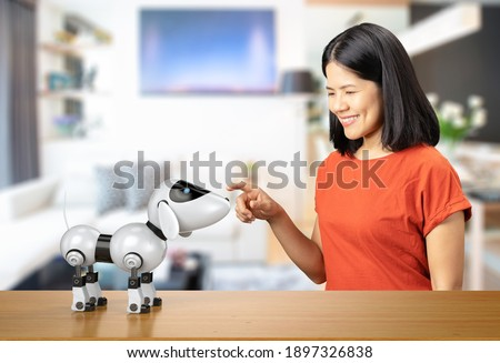 Asian woman with dog robot on white background Royalty-Free Stock Photo #1897326838
