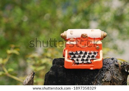 Hand home made model. Steampunk style future Typewriter on nature background.