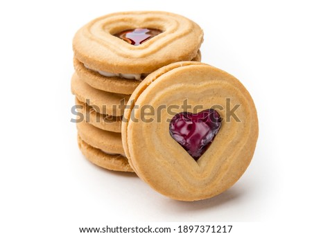Cookies. Cookie Hearts shape Red jam or strawberry jelly inside biscuit cookie. Homemade baking. Sweet bakery. Top view on white background.