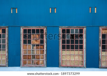 Condemned windows in an old warehouse Royalty-Free Stock Photo #1897373299