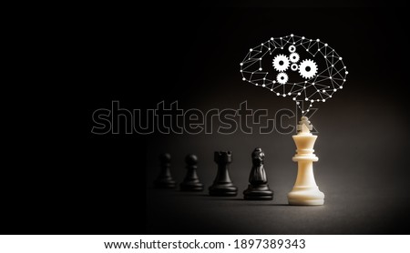 Leader with ideas and ai brain can make an impact and different concept, White chess king with graphic brain standout from all the blurred black chess  Royalty-Free Stock Photo #1897389343
