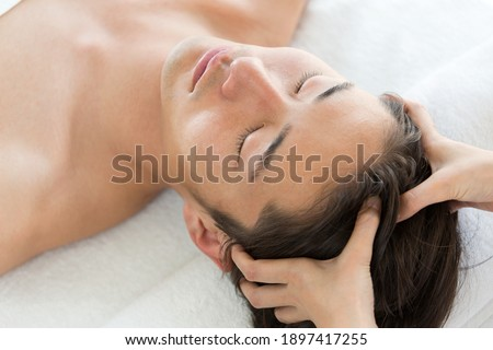 Young Asian men are head massaged. Royalty-Free Stock Photo #1897417255