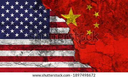 Concept of the Conflict between the United States of America and the Peoples Republik of China with painted flags on a wall with a crack Royalty-Free Stock Photo #1897498672