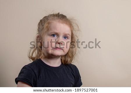 Little girl cringing. Expressive four year old makes cringe face.