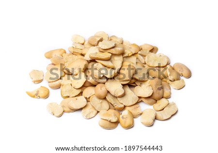 Dry broad beans on a white background Royalty-Free Stock Photo #1897544443