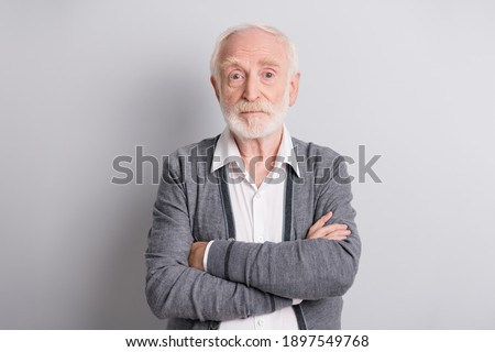 Photo of old serious man crossed arms wear dark sweater isolated on grey background