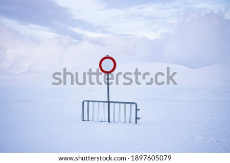no entry or transit, on a snow-covered road, over one meter of snow. desolation and silence in an abandoned landscape. Royalty-Free Stock Photo #1897605079