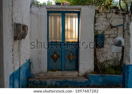 Kardamili, Peloponesse, Greece - June 01, 2019: Sun behind a closed door #1897687282