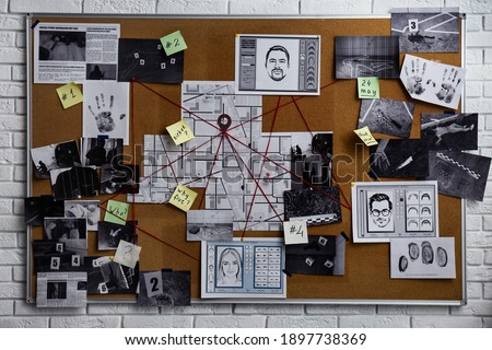 Detective board with fingerprints, photos, map and clues connected by red string on white brick wall Royalty-Free Stock Photo #1897738369