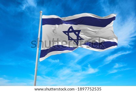 Large Israel flag waving in the wind Royalty-Free Stock Photo #1897752535